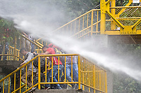 Students of the Antioquia University are sprayed with water while they a hold protest against US goverment in Medellin for the arrival of US. President Barack Obama to the Sixth Summit of the Americas in Cartagena, Colombia, 13/04/2012. Photo by Fredy Amariles / viewpress.