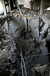 A Palestinian youth inspects the rubble of a mosque after it was hit in an Israeli missile strike in the Jebaliya refugee camp, northern Gaza Strip, Friday, Jan. 2, 2009. Israel showed no sign of slowing a blistering seven-day offensive against Gaza's Hamas rulers, destroying homes of more than a dozen of the group's operatives Friday and bombing one of its mosques a day after a deadly strike killed a prominent Hamas figure.APAIMAGES PHOTO / Ashraf Amra