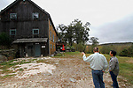 """ROXBURY, CT - 15 OCTOBER 2017 -101517JW04.jpg -- Ed Cady talks about building the exterior rock walls around his home with HGTV's """"You Live in What?"""" producer Kent Takano Sunday morning. Jonathan Wilcox Republican-American"""