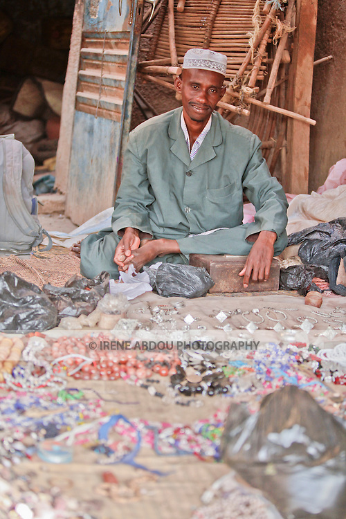In the town of Djibo in northern Burkina Faso, a blacksmith sells silver bracelets and other trinkets in the market.