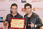 Mission Hills Chairman and CEO Ken Chu (left) shows the print of the hands of singer Jay Chou (right) on the sidelines of World Celebrity Pro-Am 2016 Mission Hills China Golf Tournament on 20 October 2016, in Haikou, China. Photo by Weixiang Lim / Power Sport Images