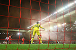 Simon Mignolet of Liverpool watches on as smoke from a flare fills the stands during the UEFA Europa League match at Anfield. Photo credit should read: Philip Oldham/Sportimage