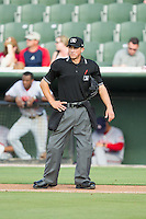 Home plate umpire Derek Gonzales between innings of the South Atlantic League game between the Hagerstown Suns and the Kannapolis Intimidators at CMC-Northeast Stadium on May 31, 2014 in Kannapolis, North Carolina.  The Intimidators defeated the Suns 3-2 in game one of a double-header.  (Brian Westerholt/Four Seam Images)