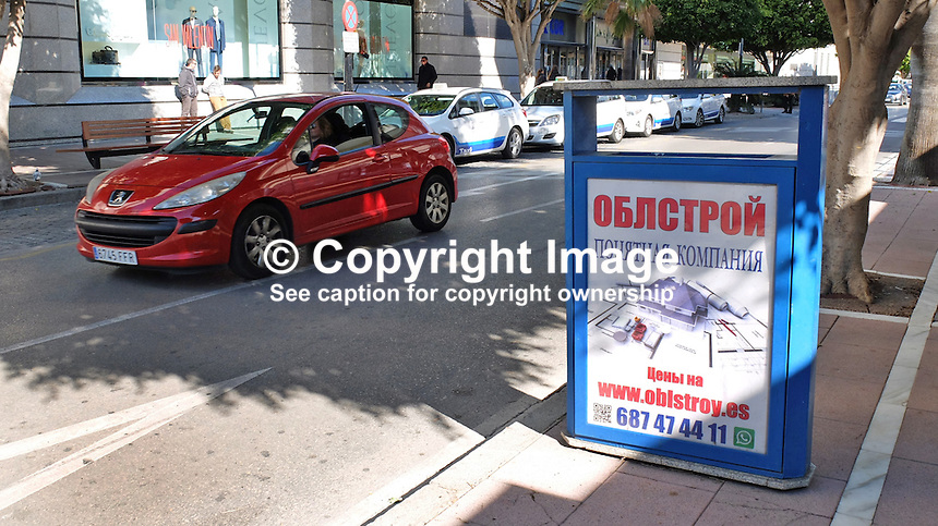 Signage in Russian on the Costa del Sol, Spain, shows its popularity with Russian ex-pats &amp; tourists. street, scene, Puerto Banus, February, 2015, 201502060388<br />