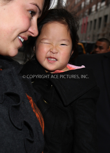 WWW.ACEPIXS.COM . . . . .  ....Janaury 23 2012, New York City....Actress Katherine Heigl's adpoted daughter Nancy Leigh Kelley being carried by her nanny on January 23 2012 in New York City....Please byline: PHILIP VAUGHAN - ACE PICTURES.... *** ***..Ace Pictures, Inc:  ..Philip Vaughan (212) 243-8787 or (646) 679 0430..e-mail: info@acepixs.com..web: http://www.acepixs.com