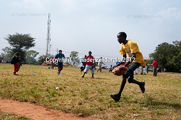 Ugandan player runs for the ball during practice session lead by Philadelphia Phillies shorstop Jimmy Rollins at the sports field of St. Peter's school in Nsambya, neighbourhood of Kampala, Uganda on January 16 2012. During practice Rollins taught backhand, forehand, running and double-play.