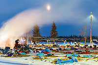 Musher headlamps streak in this time-exposure as teams rest and vapor rises from cook pots on the banks of the Yukon river at the Tanana checkpoint at 20 degrees below zero on Wednesday morning  March 11th during the 2015 Iditarod<br /> <br /> (C) Jeff Schultz/SchultzPhoto.com - ALL RIGHTS RESERVED<br />  DUPLICATION  PROHIBITED  WITHOUT  PERMISSION