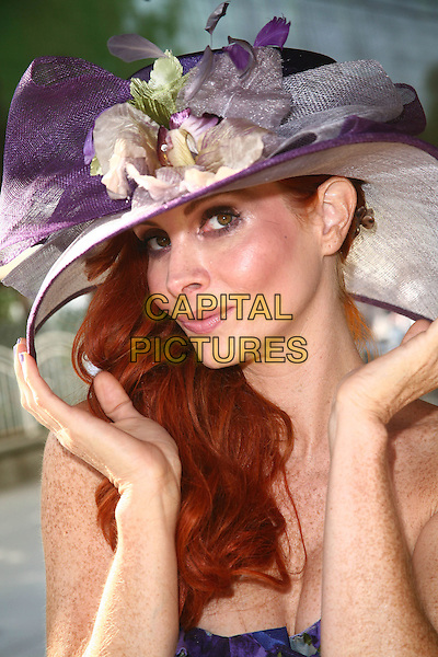 PHOEBE PRICE.19th Annual Hollywood Charity Horse Show held at the Los Angeles Equestrian Center, Burbank, California, USA..April 25th, 2009.headshot portrait purple pink flowers hat hands .CAP/ADM/TC.©T. Conrad/AdMedia/Capital Pictures.