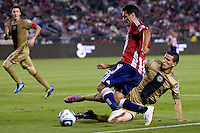 Philadelphia Union forward Sebastien Le Toux (9) attempts a tackle on CD Chivas USA defender Ante Jazic (6). The Philadelphia Union and CD Chivas USA played to 1-1 draw at Home Depot Center stadium in Carson, California on Saturday evening July 3, 2010..