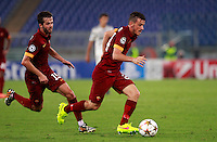Calcio, Champions League, Gruppo E: Roma vs CSKA Mosca. Roma, stadio Olimpico, 17 settembre 2014.<br /> Roma midfielder Alessandro Florenzi, followed by teammate Miralem Pjanic, of Bosnia, left, in action during the Group E Champions League football match between AS Roma and CSKA Moskva at Rome's Olympic stadium, 17 September 2014.<br /> UPDATE IMAGES PRESS/Isabella Bonotto