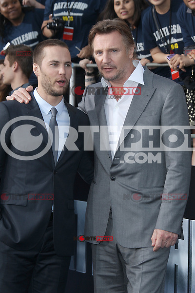 Taylor Kitsch and Liam Neeson at the film premiere of 'Battleship,' at the NOKIA Theatre at L.A. LIVE in Los Angeles, California. May, 10, 2012. ©mpi20/MediaPunch Inc.