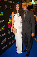 GOLD COAST, Queensland/Australia (Friday, February 24, 2012) Mick Fanning (AUS) with wife Karrisa Fanning (AUS).  The 29th Annual ASP World Surfing Awards went off tonight at the Gold Coast Convention and Exhibition Centre with the worlds best surfers trading the beachwear for formal attire as the 2011 ASP World Champions were officially crowned.. .Kelly Slater (USA), 40, and Carissa Moore (HAW), 19, took top honours for the evening, collecting the ASP World Title and ASP Womens World Title respectively.. .I have actually been on tour longer than some of my fellow competitors have been alive, Slater said. All joking aside, its truly humbling to be up here and honoured in front of such an incredible collection of surfers. I want to thank everyone in the room for pushing me to where I am...In addition to honouring the 2011 ASP World Champions, the ASP World Surfing Awards included new accolades voted on by the fans and the surfers themselves...For the first time in several years, ASP Life Membership was awarded to Hawaiian legend and icon of high-performance surfing, Larry Bertlemann (HAW), 56...Where surfing is today is where I dreamed it should be in the 70s, Bertlemann said. You guys absolutely deserve this and Im so honored to be up here in front of you all tonight..Grammy Award-winning artists Wolfmother and The Vernons rounded out the nights entertainment which was all streamed LIVE around the world on YouTube.com..Photo: joliphotos.com