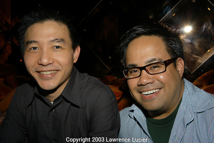NEW YORK - SEPTEMBER 17: Designer Paul Chan and Nautica executive Elmer Aglubat appear September 17, 2003, for the Chanpaul fashion show after party at Ian Schrager's Morgans Bar in New York City.