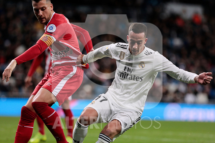 Real Madrid's Lucas Vazquez and Girona FC's Alex Granell during Copa del Rey match between Real Madrid and Girona FC at Santiago Bernabeu Stadium in Madridrm12 2019. (ALTERPHOTOS/A. Perez Meca)
