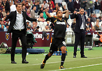 Swansea manager Paul Clement (R) points forward while Kyle Naughton of Swansea City takes a throw in during the Premier League match between West Ham United v Swansea City at the London Stadium, London, England, UK. Saturday 30 September 2017
