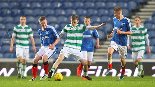 28.04.2016. Ibrox Stadium, Glasgow, Scotland. Youth Glasgow Cup Final. Rangers U17 versus Celtic U17. Ewan Henderson battles for the ball