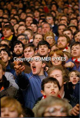 LIVERPOOL SUPPORTER AND GIRLFRIEND IN THE KOP,