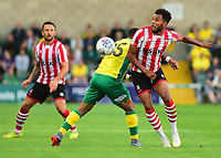 Lincoln City's Matt Green vies for possession with Norwich City's Onel Hernandez<br /> <br /> Photographer Andrew Vaughan/CameraSport<br /> <br /> Football Pre-Season Friendly - Lincoln City v Norwich City - Tuesday 10th July 2018 - Sincil Bank - Lincoln<br /> <br /> World Copyright &copy; 2018 CameraSport. All rights reserved. 43 Linden Ave. Countesthorpe. Leicester. England. LE8 5PG - Tel: +44 (0) 116 277 4147 - admin@camerasport.com - www.camerasport.com