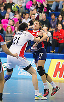 22 OCT 2011 - LONDON, GBR - Britain's Ewa Palies (#17 / in blue and red) passes as she is tackled by Russia's Viktoriya Zhilinskayte (#21 - white) during the Women's 2012 European Handball Championship qualification match between the two teams at the National Sports Centre at Crystal Palace (PHOTO (C) NIGEL FARROW)