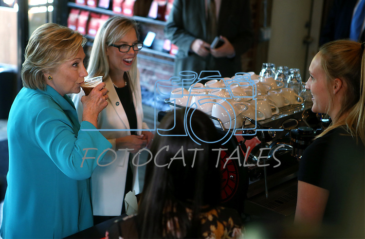 Democratic presidential nominee Hillary Clinton and Reno Mayor Hillary Schieve talk with Hub coffee shop workers during a campaign stop in Reno, Nev., on Thursday, Aug. 25, 2016. Cathleen Allison/Las Vegas Review-Journal