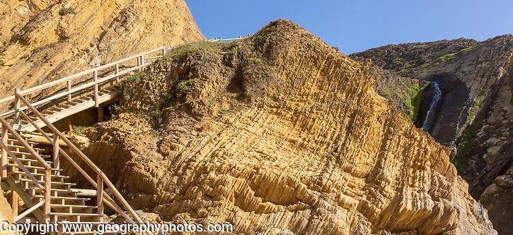 Folded sedimentary rock strata dipping downwards in cliff at Praia dos Alteirinhos, Zambujeira do Mar, Parque Natural do Sudoeste Alentejano e Costa Vicentina, Costa Vicentina and south west Alentejo natural park, Zambujeira do Mar, Alentejo Littoral, Portugal, southern Europe