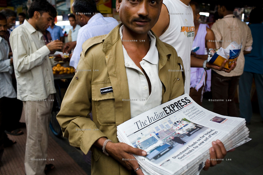 Passengers rush to buy Idly Sambhar, a south Indian speciality, during a 15 minute stop at Nagpur station, Maharashtra, while a newspaper wallah sells Indian daily newspapers...Train passengers on the Himsagar Express 6318 going from Jammu Tawi station to Kanyakumari on 8th July 2009.. .6318 / Himsagar Express, India's longest single train journey, spanning 3720 kms, going from the mountains (Hima) to the seas (Sagar), from Jammu and Kashmir state of the Indian Himalayas to Kanyakumari, which is the southern most tip of India...Photo by Suzanne Lee / for The National