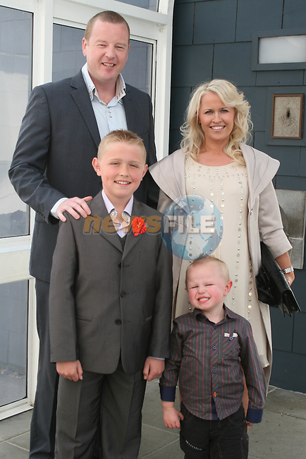 Aaron Graham Doyle with Glenn, Lisa and Brendan O'Brien at Scoil an Spioraid Naoimh NS Confirmation in Laytown Church....Photo NEWSFILE/Jenny Matthews.(Photo credit should read Jenny Matthews/NEWSFILE)....This Picture has been sent you under the condtions enclosed by:.Newsfile Ltd..The Studio,.Millmount Abbey,.Drogheda,.Co Meath..Ireland..Tel: +353(0)41-9871240.Fax: +353(0)41-9871260.GSM: +353(0)86-2500958.email: pictures@newsfile.ie.www.newsfile.ie.FTP: 193.120.102.198.