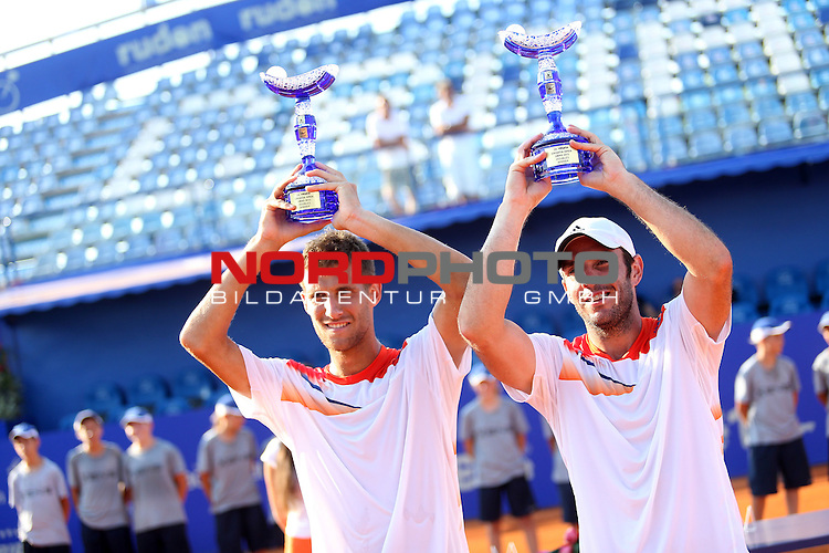 07/27/2013., Umag - 24th Vegeta Croatia Open tennis tournament. Finale pairs award. Won the first place Martin Klizan and David Marrero, and Nicholas Monroe and Simon Stadler won second place.<br /> <br /> Foto &not;&copy;  nph / PIXSELL / Peter Glebov