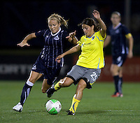 Lene Mykjaland (7) of the Washington Freedom closes in on Tina DiMartino (25) of the Philadelphia Independence during their game at the Maryland SoccerPlex in Boyds, Maryland.  The Washington Freedom defeated the Philadelphia Independence, 2-0.