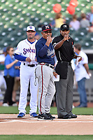 Tennessee Smokies manager Mark Johnson (8), Mississippi Braves manager Luis Salazar (4) and home plate umpire Edwin Moscoso discuss the ground rules before a game at Smokies Stadium on April 12, 2017 in Kodak, Tennessee. The Braves defeated the Smokies 6-2. (Tony Farlow/Four Seam Images)