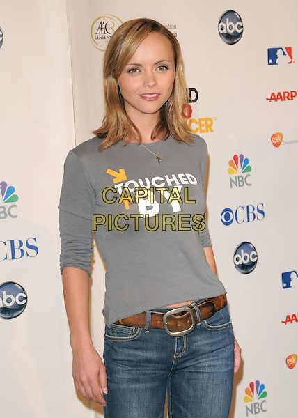 CHRISTINA RICCI .Attending Stand Up To Cancer held at The Kodak Theatre in Hollywood, California, USA, September 05 2008.                                                                     .half length grey gray top jeans brown belt.CAP/DVS.©Debbie VanStory/Capital Pictures