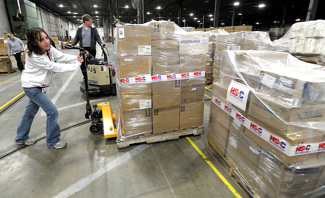 Medical relief supplies destined for Haiti earthquake victims are prepared for shipment by Kristy Meiskey, left and Becky Mentzer, right, employees of the henry Schein Company Thursday, Jan. 14, 2010 in Denver, Pa. (AP Photo/Bradley C Bower)