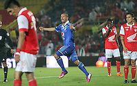 BOGOTA -COLOMBIA. 22-02-2014. Andres Felipe Cadavid de Millonarios   celebra su gol contra Independiente  Santa Fe  partido por la septima fecha de La liga Postobon 1 disputado en el estadio Nemesio Camacho El Campin. /  Andres Felipe Cadavid of Millonarios  celebrates his goal  against Indeoendiente Santa Fe   during the match for the seventh round of The Postobon one league match at Nemesio Camacho El Campin  Stadium . Photo: VizzorImage/ Felipe Caicedo / Staff