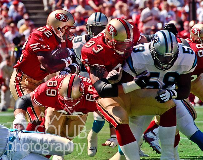 San Francisco 49ers vs. Carolina Panthers at Candlestick Park Sunday, September 10, 2000. Panthers beat 49ers 38-22.  San Francisco 49ers guard Phil Ostrowski (69) and defensive end John Milem (93) block Carolina Panthers linebacker Deon Humphrey (58) for 49ers wide receiver Kevin Williams (82).