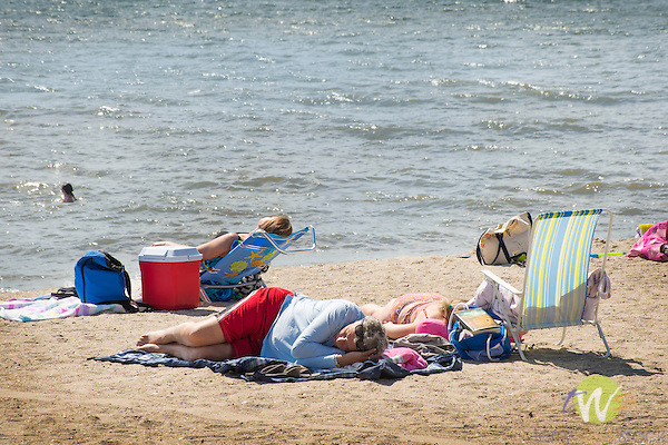 Hammonasset Beach State Park, New Haven County, Madison, Connecticut. People on beach sunbathing.