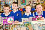 The older pupils at Raheen National School are taking time out to help younger classes with their reading as part of the ongoing reading challenge at the school. .L-R Jack Leader with his mentor Jonathon Bowler, Aaron O'Connor and his mentor Sinead Warren.