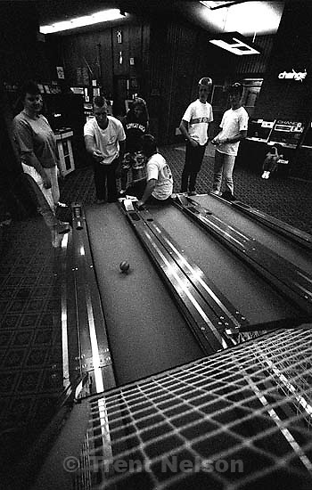 People playing skee-ball. Goof off shots around BYU (this was to test the new TMAX 3200 film, rated at 6400 ASA and mostly shot with a 15mm lens).&amp;#xA;<br />