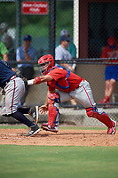 Philadelphia Phillies catcher Rafael Marchan (6) tags a batter after a dropped third strike during an Instructional League game against the Atlanta Braves on October 9, 2017 at the Carpenter Complex in Clearwater, Florida.  (Mike Janes/Four Seam Images)