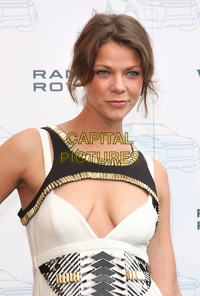 JESSICA SCHWARZ.Attends the Range Rover 40th Anniversary Party in association with Vogue at the Orangery, Kensington Palace, London, England, Uk, .July 1st 2010..half length white black gold metal cut out cleavage dress embellished neckline .CAP/ROS.©Steve Ross/Capital Pictures.