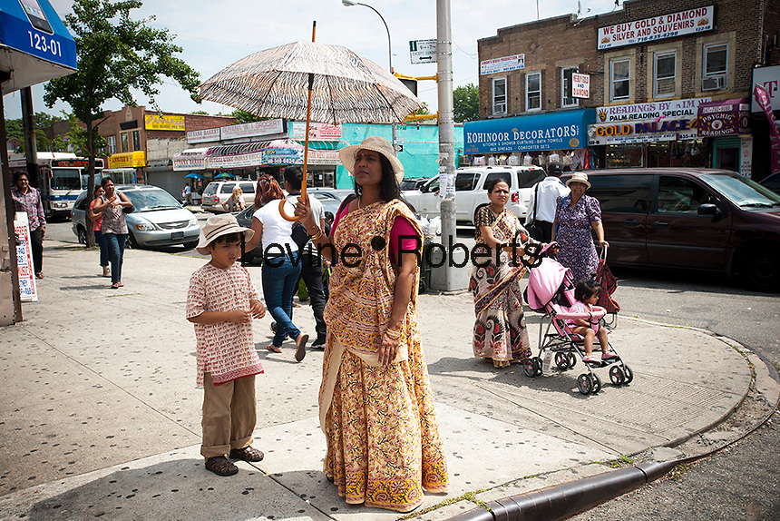 Shoppers and businesses in Richmond Hill in the New York borough of Queens on Sunday, August 5, 2012. The neighborhood of Richmond Hill is a polyglot of ethnic cultures. It is home to Pakistanis, Indians, Guyanese and has a large Sikh population.  (© Richard B. Levine)