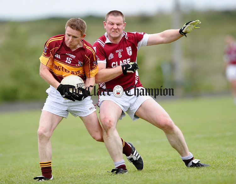 Miltown's Eoin Curtin in action against Doora Barefield's Declan O Halloran during their game at Kilmihil. Photograph by John Kelly.