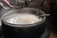 Noodles are cooked in simmering kettles over a wood fire in the traditional way at Yamauchi.