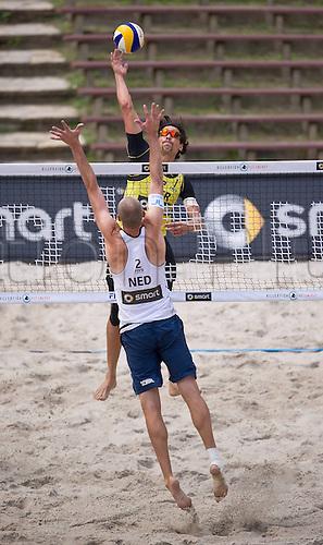 12.07.2012. Berlin, Germany.  2012 Berlin Beach Volleyball Swatch World Tour 2012 Jonathan Erdmann team ger blocks at the net