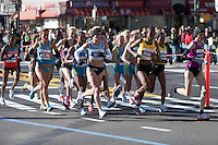 NEW YORK - NOVEMBER 7: The lead group of professional women, led by Christelle Daunay of France, approaches the 8 mile mark on 4th avenue in the 2010 New York City Marathon.  The race was won by Edna Kiplagat of Kenya in 2:28:20.