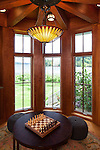 Craftsman-inspired tower room with game table. This image is available through an alternate architectural stock image agency, Collinstock located here: http://www.collinstock.com