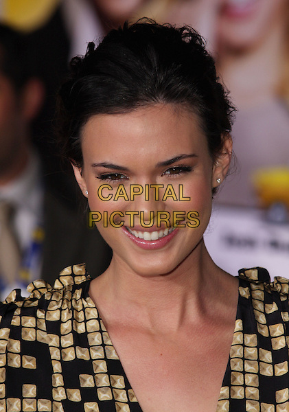 "ODETTE YUSTMAN .""When In Rome"" Los Angeles Premiere - Arrivals held at The El Capitan Theater, Hollywood, CA, USA, .27th January 2010..portrait headshot gold beige black print pattern hair up smiling.CAP/ADM/CH.©Charles Harris/AdMedia/Capital Pictures"