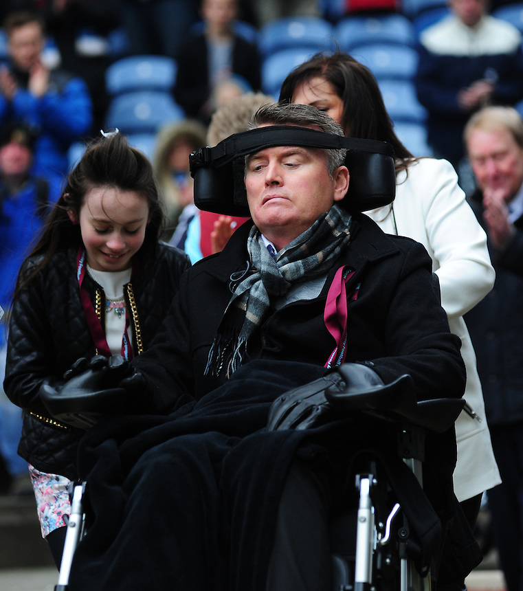 Former Burnley and Middlesbroough defender Gary Parkinson who has been left with Locked-In Syndrome since suffering a stroke in 2010 on the pitch at half time<br /> <br /> Photo by Chris Vaughan/CameraSport<br /> <br /> Football - The Football League Sky Bet Championship - Burnley v Middlesbrough - Saturday 12th April 2014 - Turf Moor - Burnley<br /> <br /> &copy; CameraSport - 43 Linden Ave. Countesthorpe. Leicester. England. LE8 5PG - Tel: +44 (0) 116 277 4147 - admin@camerasport.com - www.camerasport.com