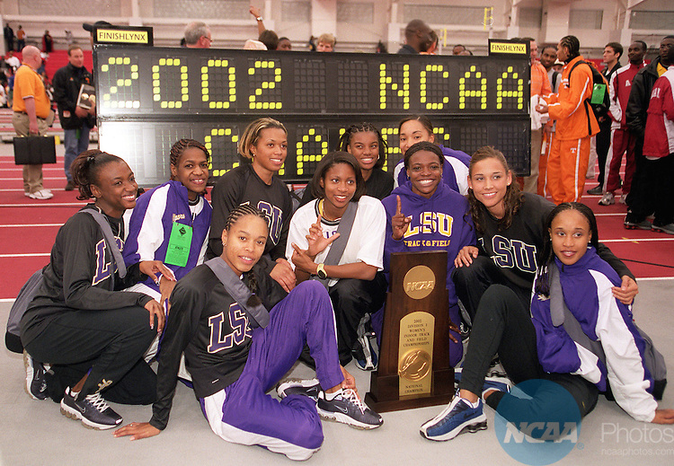 09 MAR 2002:  The LSU team shows off their first place trophy following the Division 1 Indoor Track and Field Championships held at the Randal Tyson Track Center on the University of Arkansas campus in Fayetteville, AR.  LSU had a team score of 57 points.  Gary Yandell/NCAA Photos