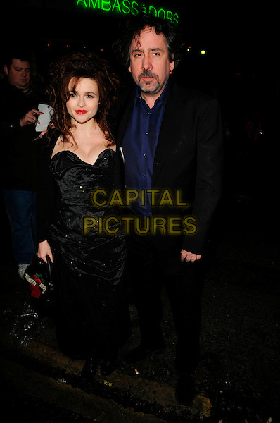 HELENA BONHAM-CARTER & TIM BURTON.At The Evening Standard British Film Awards, The Ivy,.London, England, February 3rd 2008..full length black Vivienne Westwood dress suit blue shirt couple Lulu Guinness bag red heart.CAP/CAN.?Can Nguyen/Capital Pictures