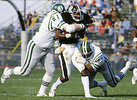 Bryan Poley and Brian Illerbrun(61) Saskatchewan Roughriders tackle Mike Nelms punt returner for the Ottawa Rough Riders.  Copyright photograph Scott Grant